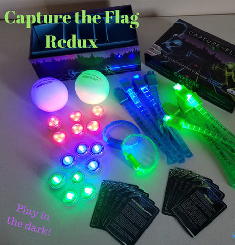 The equipment for the glow-in-the-dark capture-the-flag game is shown lying on a table, and glowing during the night.