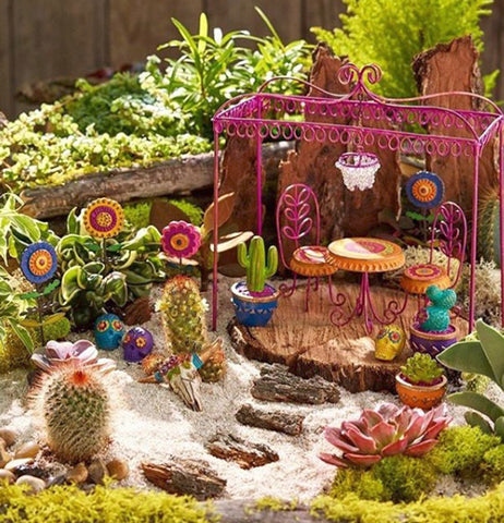 "The (Mini) ""Button Flower"" Garden Picks gets along well with other miniature models outside the garden."