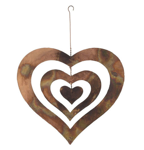 Copper garden triple heart spinner with chain and hook over a white background.