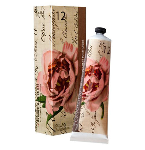 This Shea butter lotion with a soft on the eye flower on the tube and box. The tube is placed next to the box.