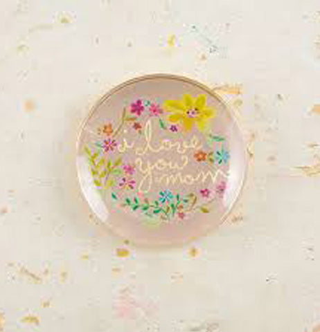 "Beige glass tray with a pink and yellow floral design and ""I Love you mom"" in the center sitting on a white table with gold specks"