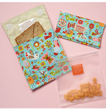 Set of 3 reusable snack bags. 2 have birds and butterflies 1 is a clear bag.