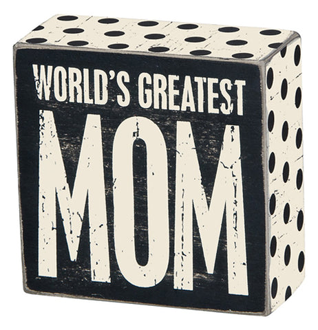 "Black and white box sign that says"" World's Greatest Mom."""