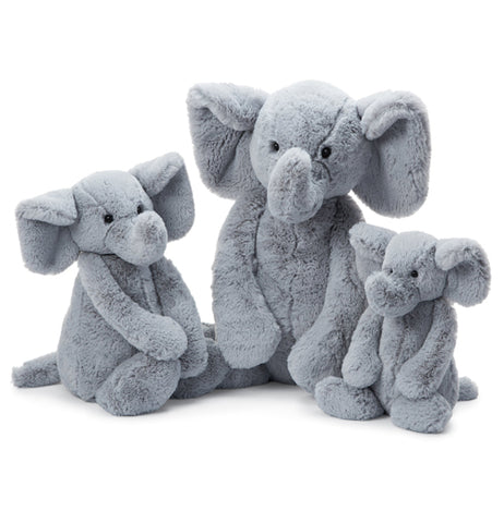 "The Bashful Medium ""Grey Elephant"" sits between two baby grey elephants."