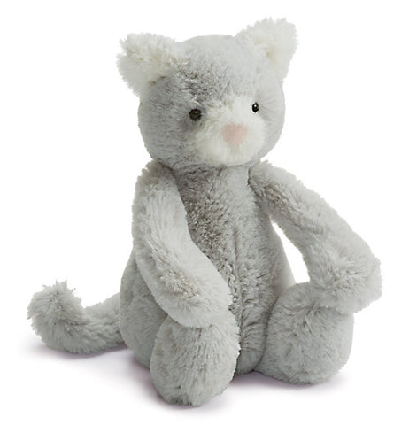 This plush grey kitty toy is shown playing with its feet.