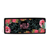 "This black pencil case has pink flowers around the boarder with the words ""Wild At Heart."""