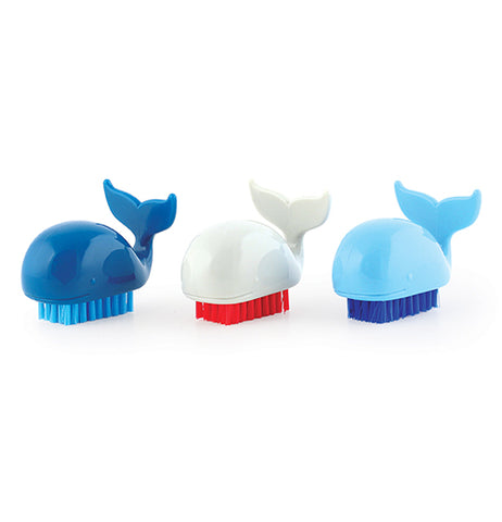 These differently colored fingernail scrubbers are shaped like whales. The first one is dark blue with light blue bristles, the second is white with red bristles, and the third is light blue with dark blue bristles.
