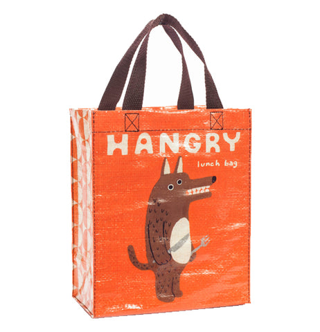 An orange bag with a caption and an angry looking dog with utensils in his paws.