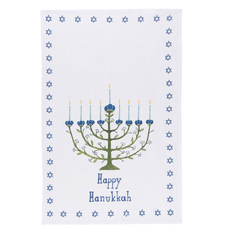 white dish towel with a border of little blue star of davids and a green tree in the shape of a menorah with white candles and the words happy hanukkah in blue underneath