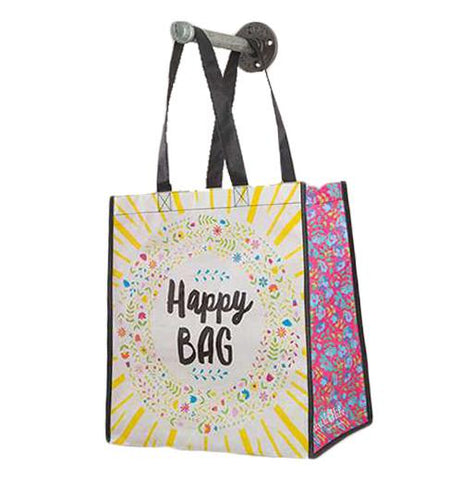 "A large recycled gift bag that says ""Happy Bag"" surrounded with flowers and rays of sun."
