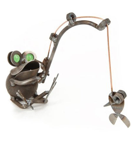 This metal sculpture is shaped like a frog with green eyes catching a small fish on a fishing pole.