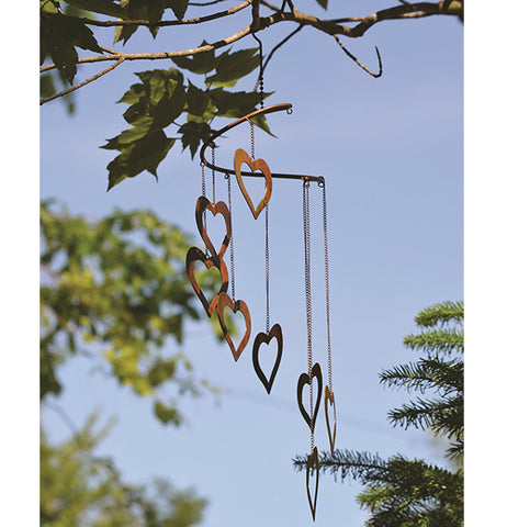 Hearts Spiral Mobile hanging from a tree branch.