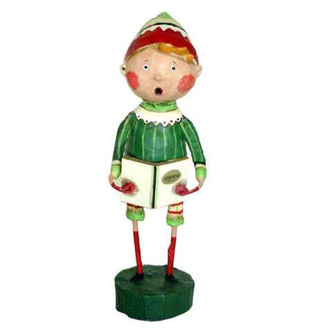 A caroling figurine wearing a green and red knit cap and green with white stripe shirt holding a caroling book.
