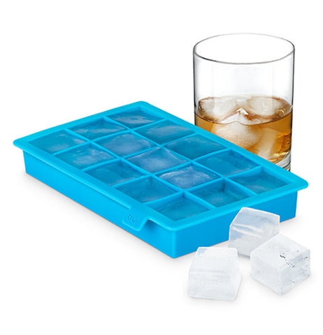 Ice cube tray that is blue and holds up to fifteen ice cubes shown with a glass holding liquid and ice.