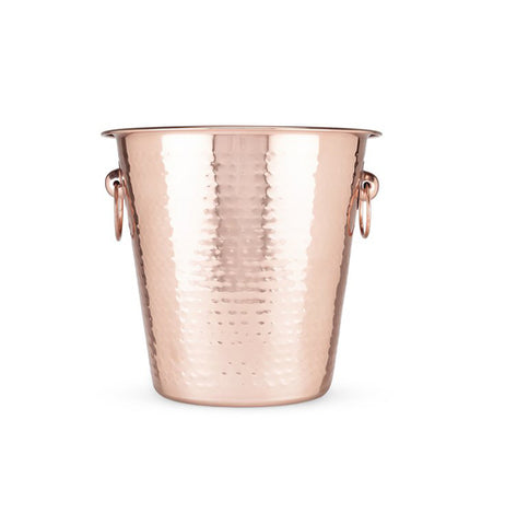 Hammered copper ice bucket with handles on the side.