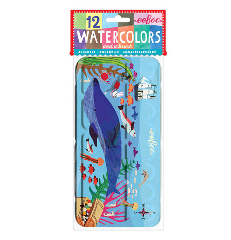 12 watercolors in a case that shows a picture of a whale and a ship with various other underwater creatures.