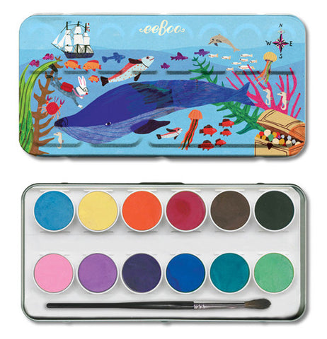 The cover to the water color case sits above the bottom the different colors in the kit.