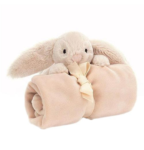 This baby blanket has a stuffed bunny attached to it. It is shown wrapped and tied up.