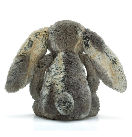 The Woodland Bashful Bunny who is furry and brownish sits on the back.