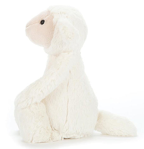 Side view of a bashful medium lamb.