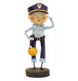 This boy figurine is shown wearing a police costume holding a pumpkin candy basket and a handgun strapped to the belt on his waist.
