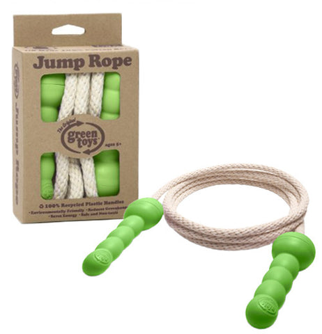 This jump rope with green handles is made from recycled materials. One rope is shown in its cardboard packaging, while the other is seen coiled up and lying outside the box.