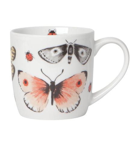 "White ""Fly Away"" mug with a design that features a pink, white, and black butterfly, black and white moth, and black spotted red ladybug over a white background."