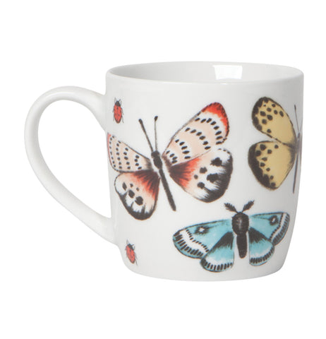 "White ""Fly Away"" mug with a design that features a black spotted red ladybugs, a red, white, and black butterfly, a yellow and black butterfly, a blue, black, and white moth over a white background."