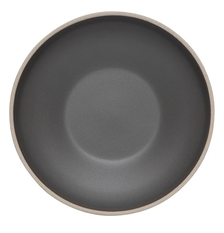 The inside of a black bowl shown from a picture taken above.