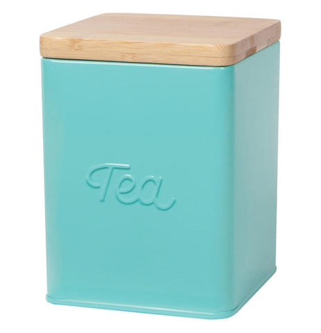"This Aqua Tea tin has a wooden lid and the word ""Tea"" embossed in the middle"
