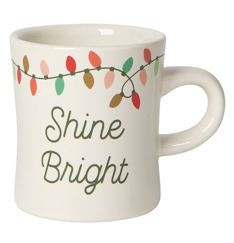 "The ""Christmas Lights' Diner Mug has the vintage shape of the stoneware cup that features Christmas lights and the words, ""Shine Bright"" below it."