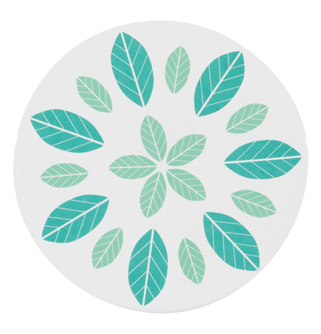 White trivet with light green leaves in the center and light and dark green leaves around the perimeter.