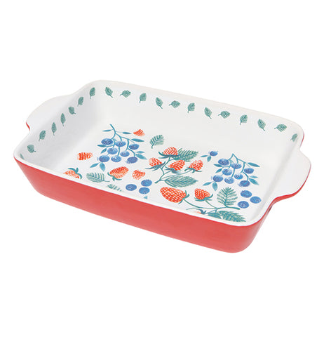 This baking dish has a red exterior and a white interior. At the bottom of the dish's interior is design of blueberries, strawberries, and raspberries. Near the rim of the pan's interior are green leaves.