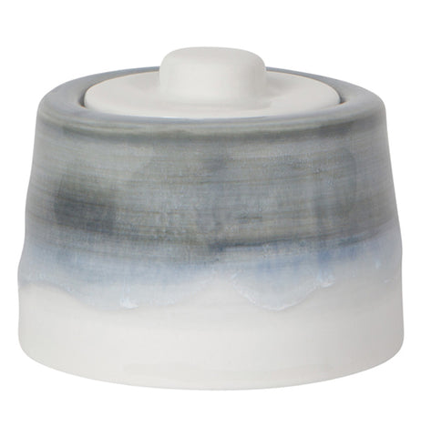 "This is a ""Cloud Gray"" sugar Pot that has a white lid on the top."