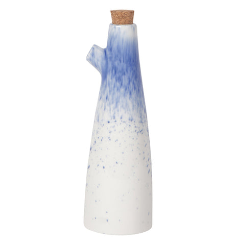 A cone shaped white vinegar cruet with some blue at the top near the spout and spots at the bottom.
