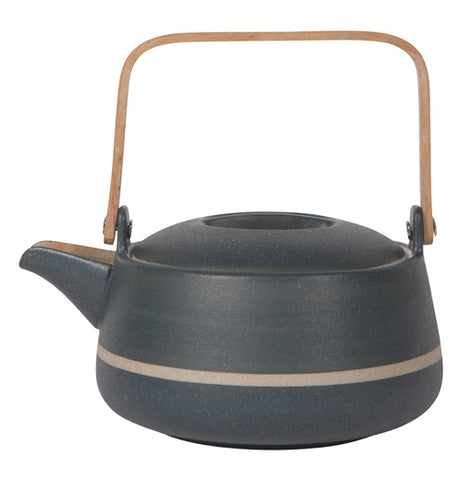 A dark Teapot shaped like an orb with a white stripe in the middle and a wooden handle raised.