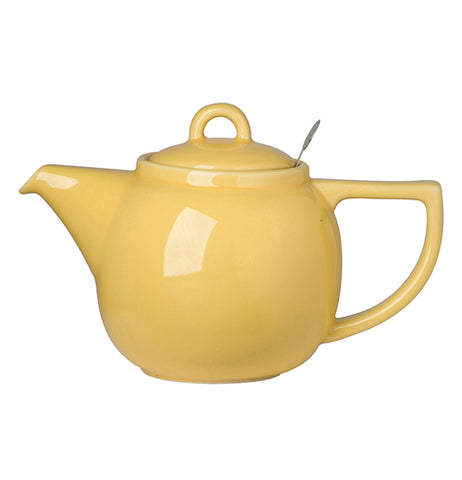 A little yellow teapot short and stout. It has a handle and it has a spout.