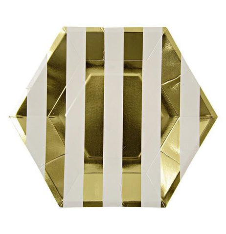 A gold and white stripped plate that is a hexagon shapped plate.