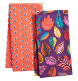 These tea towels have different colored leaves some are orange others are blue and yellow one has a purple background the other has an orange background.
