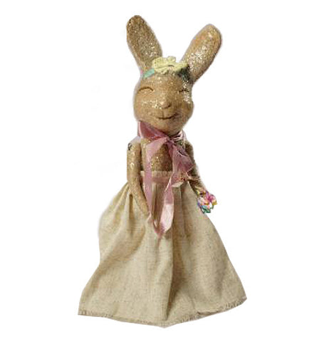 This lady rabbit is brown and has a brown dress on with a pink bow around her neck.