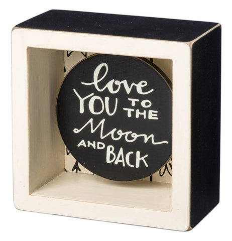 "Black and white box sign that says ""Love you to the moon and back."""