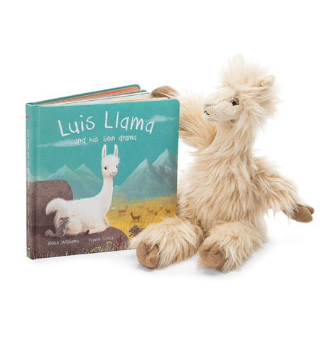 "The white and fury Luis the Llama sits with the ""Luis Llama and His Llama Drama"" Book."