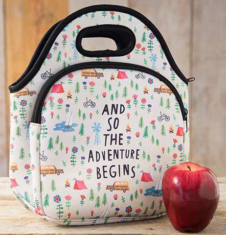 "This neoprene lunch bag is decorated with a design of cars, bicycles, tents, windmills, and fir trees. In the middle of the bag are the words, ""And So The Adventure Begins"" in black lettering."