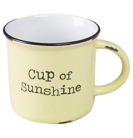 "This yellow mug has a black outline at its top. Inside the cup is white. In the middle of the cup, on the outside, are the words, ""Cup of Sunshine"" in black lettering."