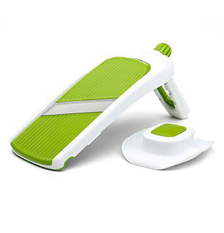 Green and white collapsible vegetable slicer.