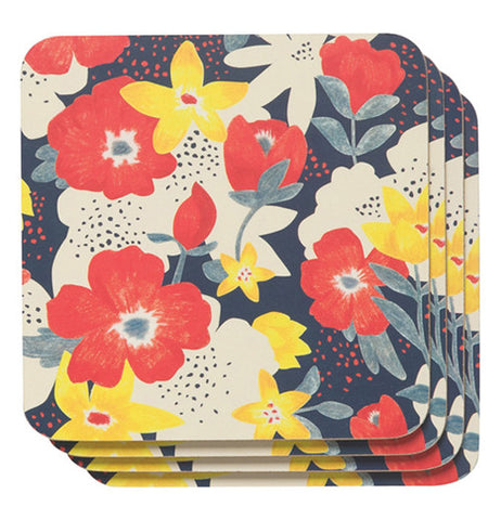 Dark blue cork backed coaster with a myriad of red, yellow and white flowers.
