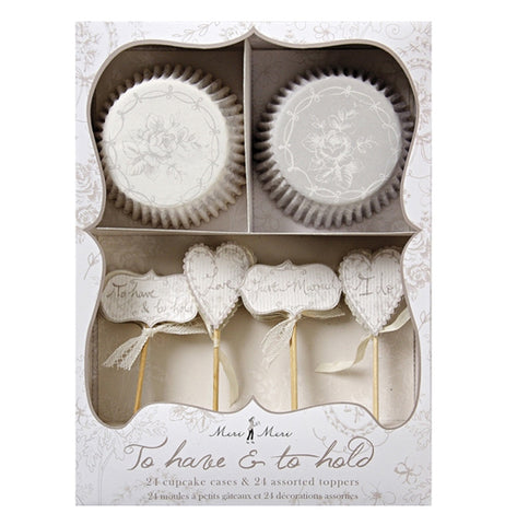 12 silver and 12 white cupcake holders with 24 toppers in 4 different bridal designs all in the silver packaging box.