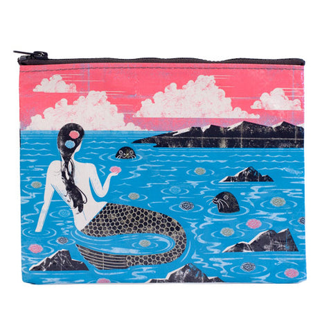 Blue and pink zipper pouch with an image of a mermaid sitting on rocks holding a flower looking at a seal.