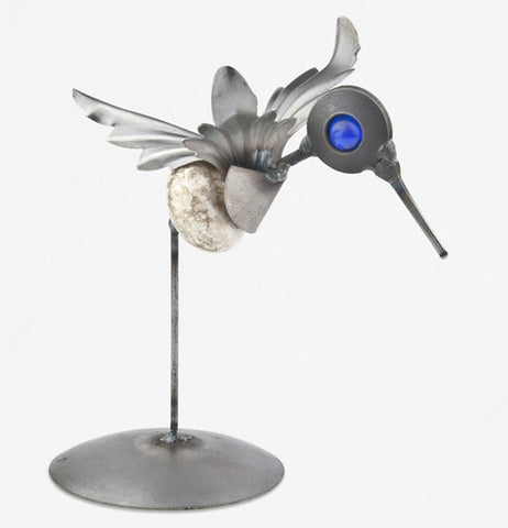 The metal hummingbird sculpture is shown from the opposite side angle.