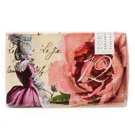 Perfume Soap with a rose and a girl illustrated on it.